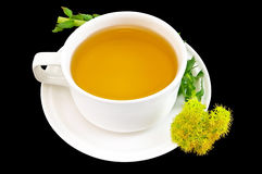 Herbal tea with flower golden root Royalty Free Stock Photography