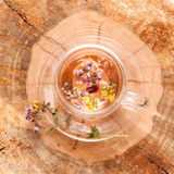 Herbal tea with flowers. Royalty Free Stock Photo