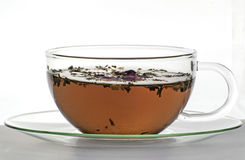 Herbal tea in a glass cup. Cup with herbal tea on white Stock Photos