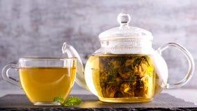 Herbal tea in a glass pot royalty free stock photos