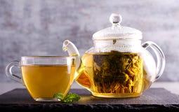 Herbal tea in a glass. Tea pot royalty free stock image