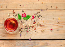 Herbal tea in a glass. Still life, healthcare, food and drink concept. Herbal tea in a glass on a wooden table. Selective focus, copy space background, top view stock images