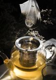 Herbal tea in a glass teapot stock photo
