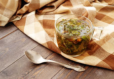 Herbal tea in a glass transparent cup on a wooden table. Royalty Free Stock Photos