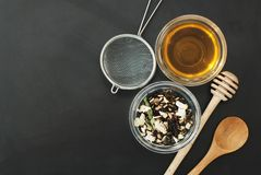 Herbal Acaccia Tea Healthy Drink in bowl and sieve over Black Background copy space. Healthy Drink, coldness. Herbal tea Healthy Drink in bowl and sieve over royalty free stock photos
