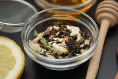 Herbal Acaccia Tea Healthy Drink in bowl and sieve over Black Background copy space. Healthy Drink, coldness. Herbal tea Healthy Drink in bowl and sieve over stock images