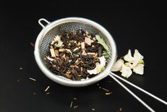 Herbal Acaccia Tea Healthy Drink in bowl and sieve over Black Background copy space. Healthy Drink, coldness. Herbal tea Healthy Drink in bowl and sieve over stock photo