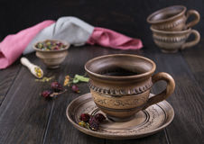 Herbal tea, herbs and flowers in a  clay cup Royalty Free Stock Photos