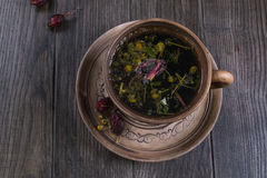 Herbal tea, herbs and flowers in a  clay cup Royalty Free Stock Photo