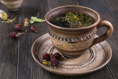 Herbal tea, herbs and flowers in a  clay cup Stock Image