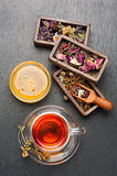 Herbal tea with honey, dried herbs and flowers Royalty Free Stock Photography