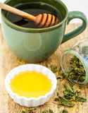 Herbal tea with honey and wooden stick Stock Images