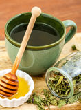 Herbal tea with honey and wooden stick Stock Image