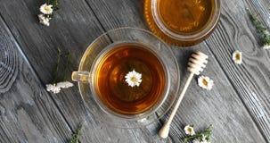 Herbal tea and jar of honey Royalty Free Stock Images