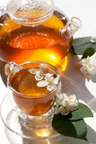 Herbal tea and jasmine flowers. In the sunlight Royalty Free Stock Photo
