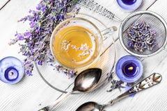 Herbal Tea with lavender. Fragrant herbal tea with flowering lavender sprigs Royalty Free Stock Images