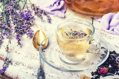Herbal tea with lavender. Natural herbal tea with flowering lavender sprigs.Photo toned Stock Image