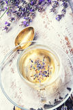 Herbal tea with lavender. Natural herbal tea with flowering lavender sprigs.Photo toned Stock Photography