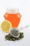 Herbal tea with lemon and honey. Herbal tea with strainer, lemon and honey jar royalty free stock photo
