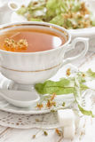 Herbal tea. With linden in a cup Royalty Free Stock Photography