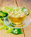 Herbal tea from linden flowers in glass cup Stock Photography