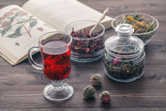 Herbal tea with Mallow flowers. And book about herbs Stock Photography