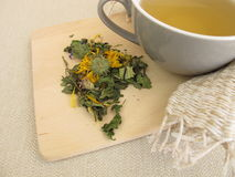 Herbal tea with marigold and cornflower. Cup of herbal tea with marigold and cornflower Royalty Free Stock Photo