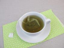 Herbal tea with matcha tea bag Stock Photos