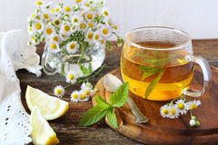 Herbal tea with mint and camomile Royalty Free Stock Photography