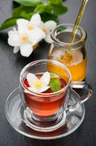Herbal tea with mint, jasmine flowers and honey. The concept of health. Stock Image