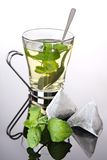 Herbal tea with mint and teabags Stock Photos