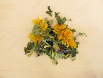Herbal tea mix with marigold and cornflower. On wooden board Stock Photo