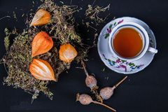 Herbal tea in a mug. With grass, soothing, with a pleasant scent, for pleasure Royalty Free Stock Photo