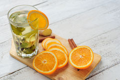 Herbal tea with orange and ginger in glass Stock Photography