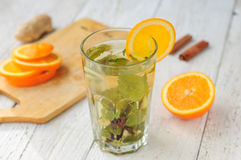 Herbal tea with orange and ginger in glass Stock Image