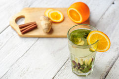 Herbal tea with orange and ginger in glass Royalty Free Stock Images