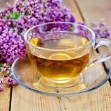 Herbal tea of oregano on board in glass cup Stock Photo