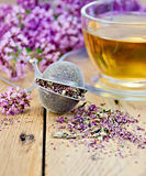 Herbal tea from oregano with strainer on board Stock Images
