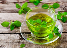Herbal tea. With organic herbs in a glass cup on a wooden table. style rustic. selective focus stock photos
