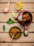 Herbal tea pot with fresh herbs sage ,peppermint ,dried indian b Royalty Free Stock Image
