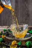 Herbal tea poured into cup Royalty Free Stock Photography