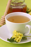 Herbal tea with primroses and honey Royalty Free Stock Images