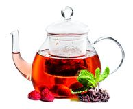 Herbal tea with raspberry in glass teapot isolated on white back royalty free stock image