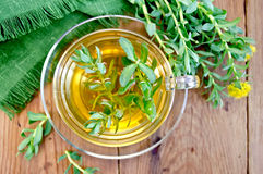 Herbal tea with Rhodiola rosea on the board Royalty Free Stock Image