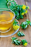 Herbal tea with Rhodiola rosea in the cup on the board Stock Photo