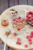 Herbal tea with rose buds and fresh raspberry. Stock Image