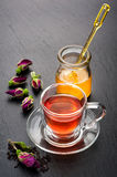Herbal tea with rose flowers and honey. Stock Photography