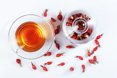 Herbal tea from rose hips, vitamin drink, hips, based on white, Royalty Free Stock Photography
