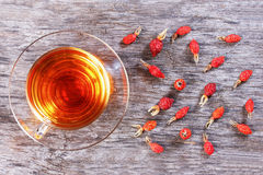 Herbal tea from rose hips, vitamin drink, hips, based on white, Stock Image