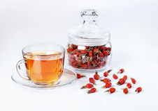 Herbal tea from rose hips, vitamin drink, rose hips on the white Stock Photos